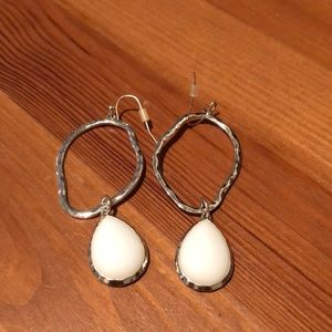 Silver drop earrings with white bead.